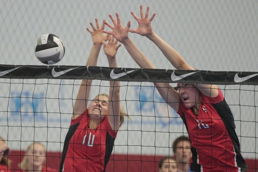 La Jolla's Abby Waldburger (left) and Madeleine Gates try to block the ball during a match in the Southern California Invitational. The Vikings are ranked No. 6 in the San Diego Section.