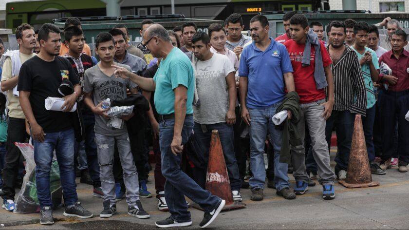 MCALLEN, TEXAS, THURSDAY, JULY 26, 2018 - A group of immigrant men are directed to the Central Stati