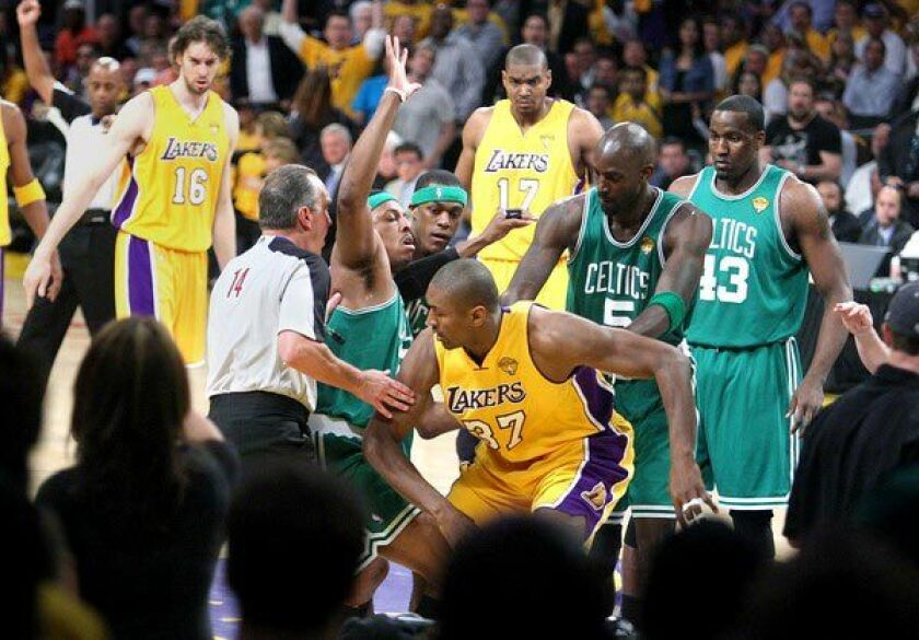 The Lakers' Ron Artest and Celtics' Paul Pierce are separated by teammates and referees after getting tangled and falling to the court during Game 1 of the 2010 NBA Finals.