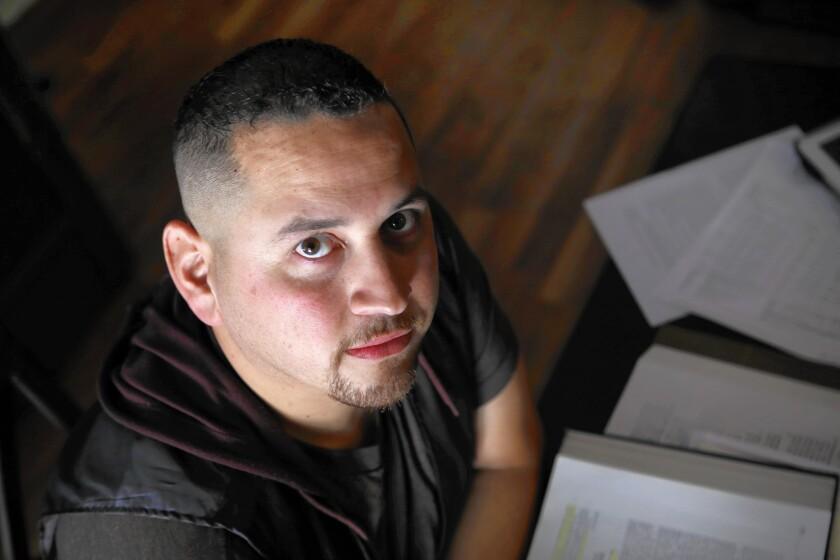 Omar Medina, a former law student at Northwestern California University, at home in Murrieta.