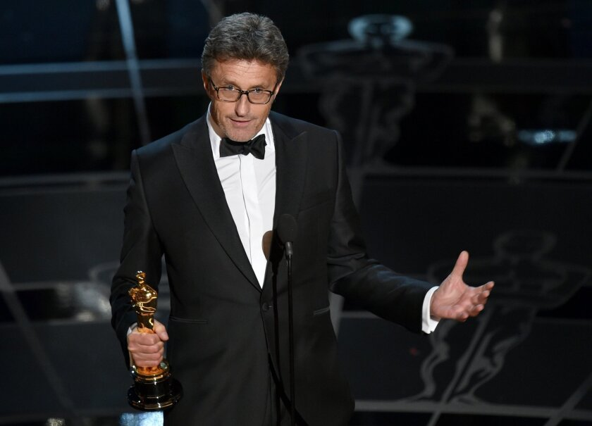"""Pawel Pawlikowski accepts the award for best foreign language film for """"Ida"""" at the Oscars on Sunday, Feb. 22, 2015, at the Dolby Theatre in Los Angeles. (Photo by John Shearer/Invision/AP)"""