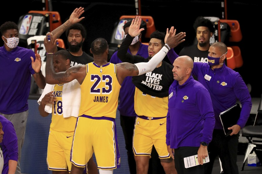 Lakers forward LeBron James celebrates with his teammates after they defeated the Clippers on Thursday night.