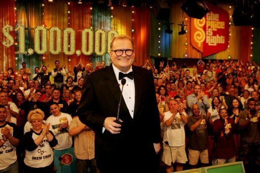 """FILE - In this February 2008 publicity image released by CBS Entertainment, host Drew Carey hosts pauses during a taping of of """"The Price is Right Million Dollar Spectacular,"""" one of six new specials to be broadcast on the CBS Television Network. A Los Angeles judge on Tuesday, March 12, 2013, overturned an $8.5 million jury verdict awarded to a former model on the show after determining that he had not properly instructed the panel. A retrial will be scheduled in Brandi Cochran's case versus th"""