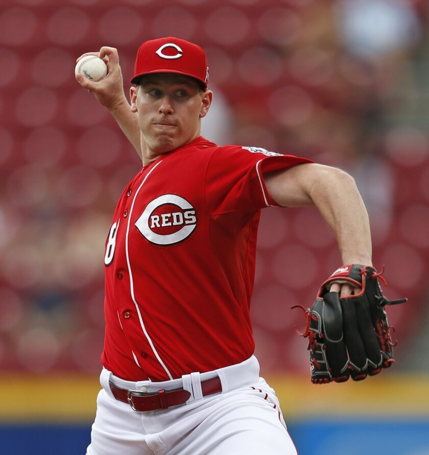 Cincinnati Reds starting pitcher Anthony DeSclafani (28) throws against the Los Angeles Dodgers during the first inning of a baseball game, Thursday, Aug. 27, 2015, in Cincinnati. (AP Photo/Gary Landers)