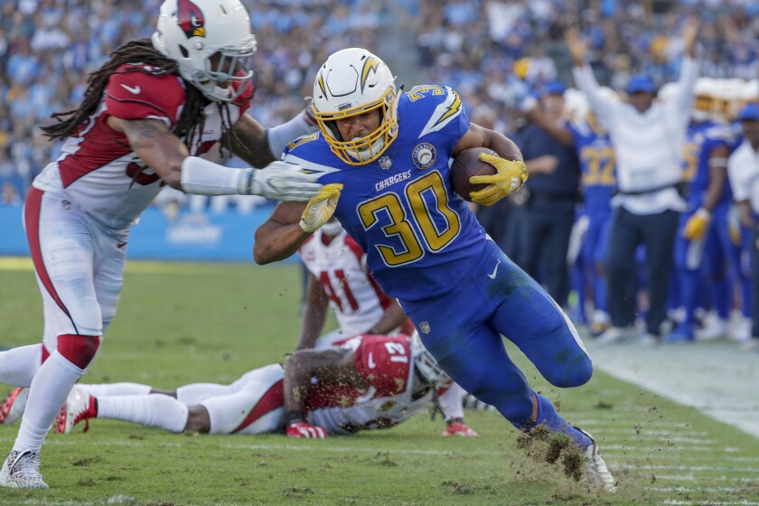 Chargers running back Austin Ekeler finishes a 13-yard run to the two-yard line during third-quarter action against the Arizona Cardinals at StubHub Center.