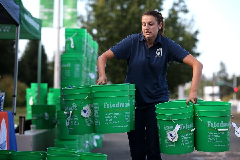 Water buckets being passed out in Sonoma County