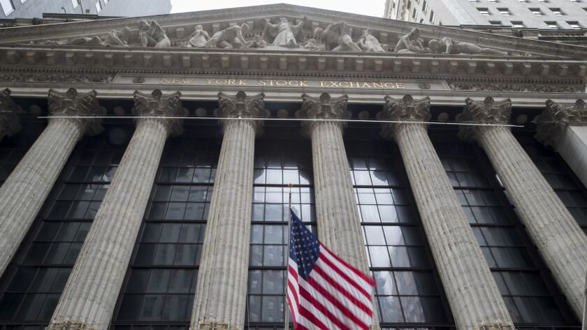 FILE - In this Nov. 20, 2018, file photo an American flag flies outside New York Stock Exchange. Sto