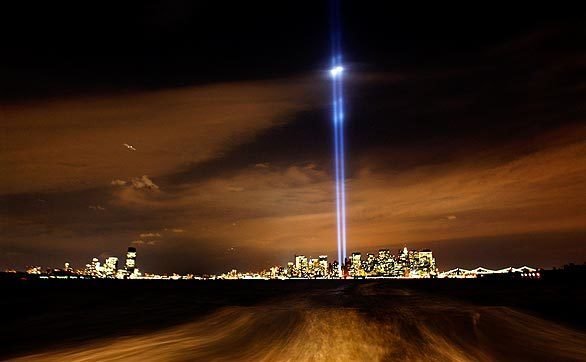 """In this Sept. 11, 2008, file photo, the New York skyline is punctuated by the """"Tribute in Lights,"""" representing the towers of the World Trade Center, as seen from the Staten Island Ferry. Best of 2008 Photography >>> Best of 2008 Main >>>"""