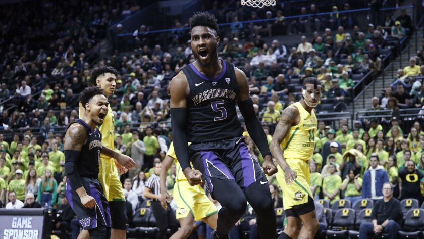 Washington's Miles Norris celebrates a dunk against Oregon during an NCAA college basketball game Th