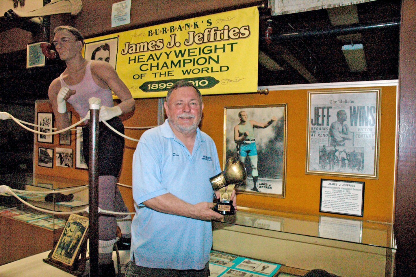 Don Baldaseroni holds the trophy given in honor of boxer James J. Jeffries from the National Boxing Hall of Fame.