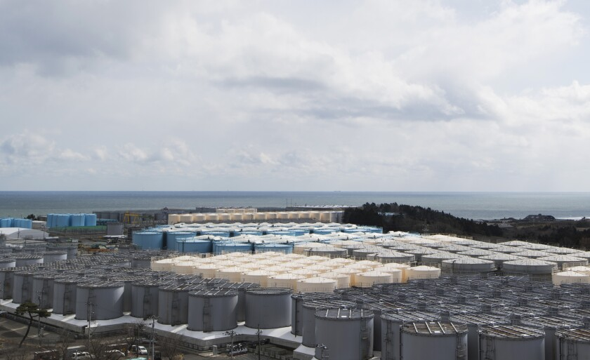FILE in In this Feb. 27, 2021, file photo, tanks (in gray, beige and blue) store water that was treated but is still radioactive after it was used to cool down spent fuel at the Fukushima Daiichi nuclear power plant in Okuma town, Fukushima prefecture, northeastern Japan. Technicians at Japan's wrecked Fukushima nuclear power plant neglected to investigate the cause of faulty filters that were discharging dangerously radioactive water into the sea, company officials admitted Tuesday, Sept. 14, 2021, after being forced to repair the filters. (AP Photo/Hiro Komae, File)