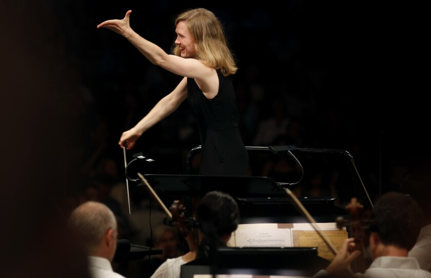 Mirga Grazinyte-Tyla conducting the Los Angeles Philharmonic at the Hollywood Bowl.