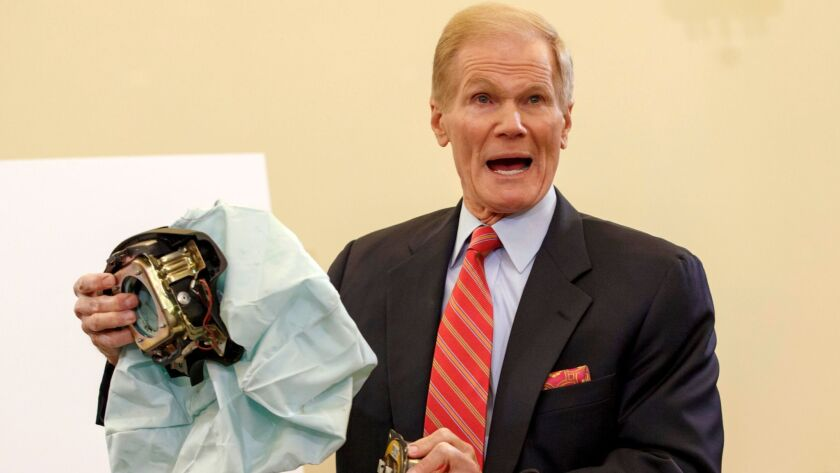 Sen. Bill Nelson (D-Fla.) holds an example of a defective Takata airbag in 2014.