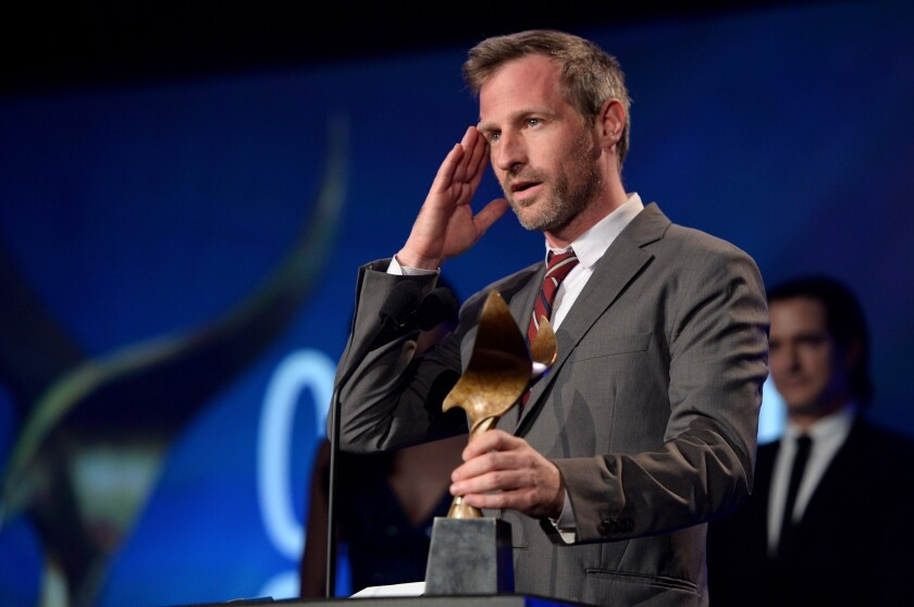 "Spike Jonze accepts the award for original screenplay for ""Her"" at the Writers Guild of America, West ceremony on Saturday night in Los Angeles."