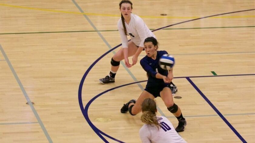 In a Sept. 27 match at La Costa Canyon, San Dieguito Academy senior Kiani Kerstetter gets under this ball with support from teammates Kiahna Holmen (10) and Kathleen Brown. LCC won the contest in three sets.