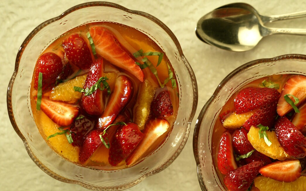 Strawberries and oranges in basil syrup
