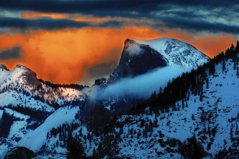 Half Dome in Yosemite National Park at sunset on a winter evening.