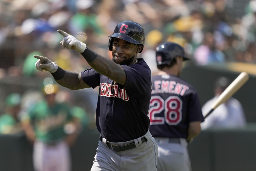 Cleveland Indians' Daniel Johnson points to the crowd after hitting a solo home run against the Oakland Athletics during the seventh inning of a baseball game Sunday, July 18, 2021, in Oakland, Calif. (AP Photo/Tony Avelar)