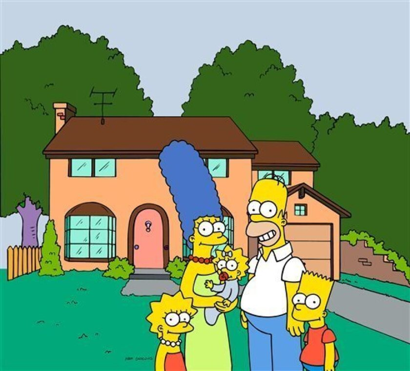 "FILE - This undated frame from the Fox series ""The Simpsons,"" shows the popular cartoon family posing in front of their home, from left, Lisa , Marge , Maggie, Homer and Bart Simpson. (AP Photo/Fox Broacasting Co.)"