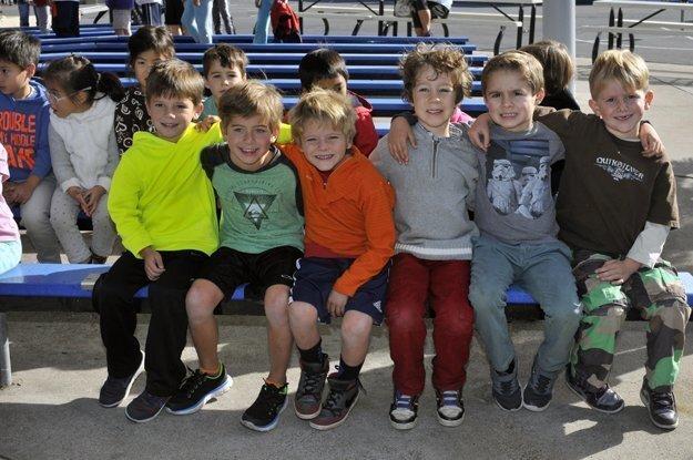 Kindergarteners wait for rehearsal