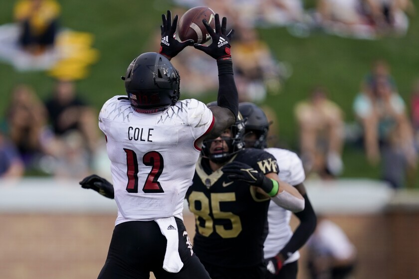 Louisville defensive back Qwynnterrio Cole intercept a passes intended for Wake Forest tight end Blake Whiteheart during the second half of an NCAA college football game on Saturday, Oct. 2, 2021, in Winston-Salem, N.C. (AP Photo/Chris Carlson)