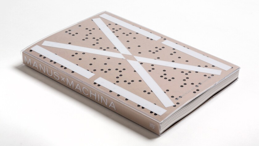 """Manus X Machina,"" published by the Metropolitan Museum of Art and distributed by Yale University Press, features a cover inspired by computer technology."