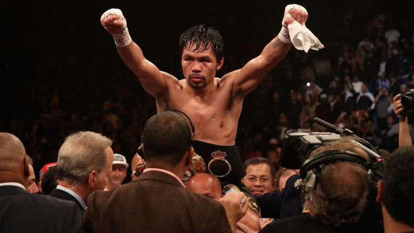 Manny Pacquiao celebrates after defeating Adrien Broner at MGM Grand Garden Arena on Jan. 19.