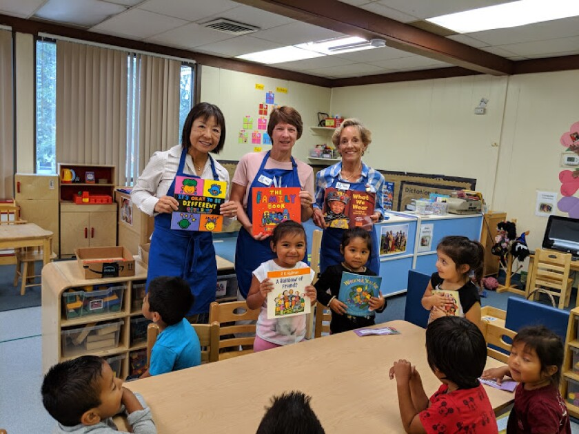 Assistance League of Rancho San Dieguito volunteers with children at Solana Beach Head Start.