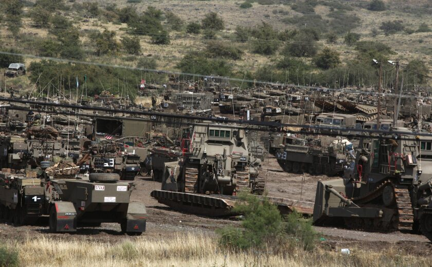 Israeli tanks are seen by the Israeli-Syrian border before the start of a military exercise.