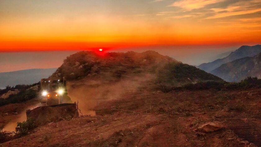 In this photo released by Santa Barbara County Fire Department, a dozer from the Santa Barbara Count