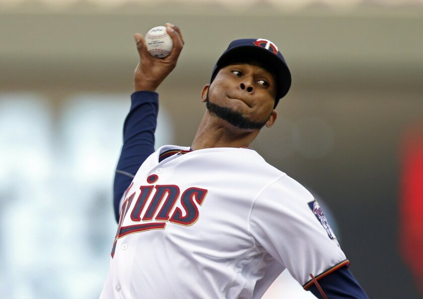 Minnesota Twins pitcher Ervin Santana throws against the Toronto Blue Jays during the first inning of a baseball game Thursday, May 19, 2016, in Minneapolis. (AP Photo/Jim Mone)