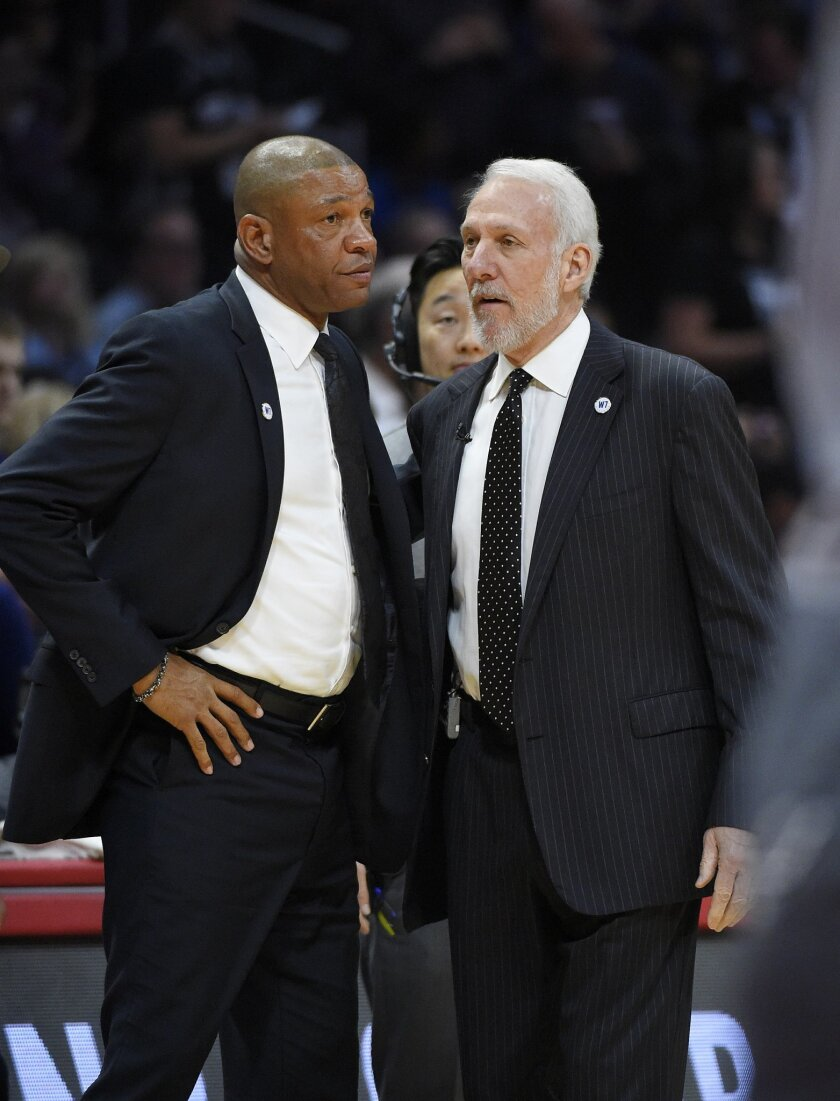 Los Angeles Clippers coach Doc Rivers, left, and San Antonio Spurs coach Gregg Popovich chat prior to an NBA basketball game Thursday, Feb. 18, 2016, in Los Angeles. (AP Photo/Mark J. Terrill)
