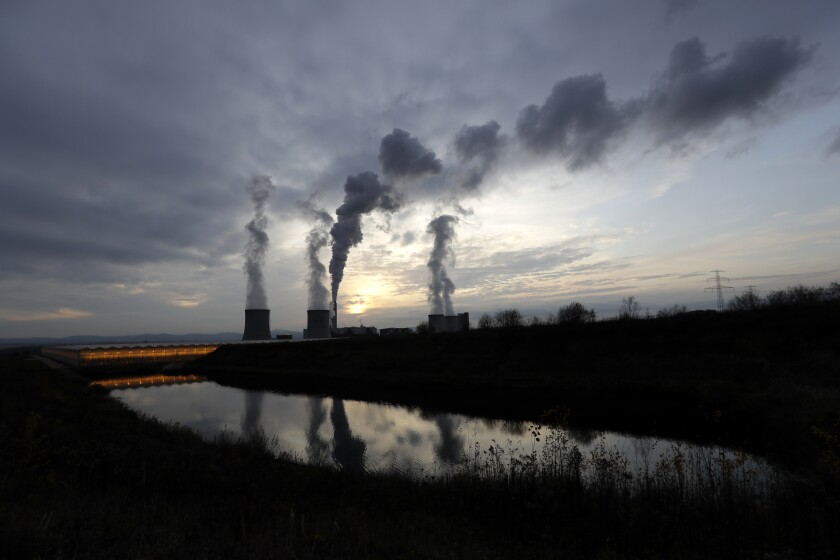 FILE - In this Tuesday, Nov. 19, 2019 file photo, smoke rises from chimneys of the Turow power plant located by the Turow lignite coal mine near the town of Bogatynia, Poland. The European Union's top court says the Czech Republic is pressing for Poland to be fined 5 million euros for every day it ignores the court's order last month to immediately shut a lignite mine near the two countries' border. The announcement by the European Court of Justice came Tuesday, June 15, 2021 as Poland approved a strategy for the upcoming talks with the Czechs over the Turow mine. (AP Photo/Petr David Josek, file)