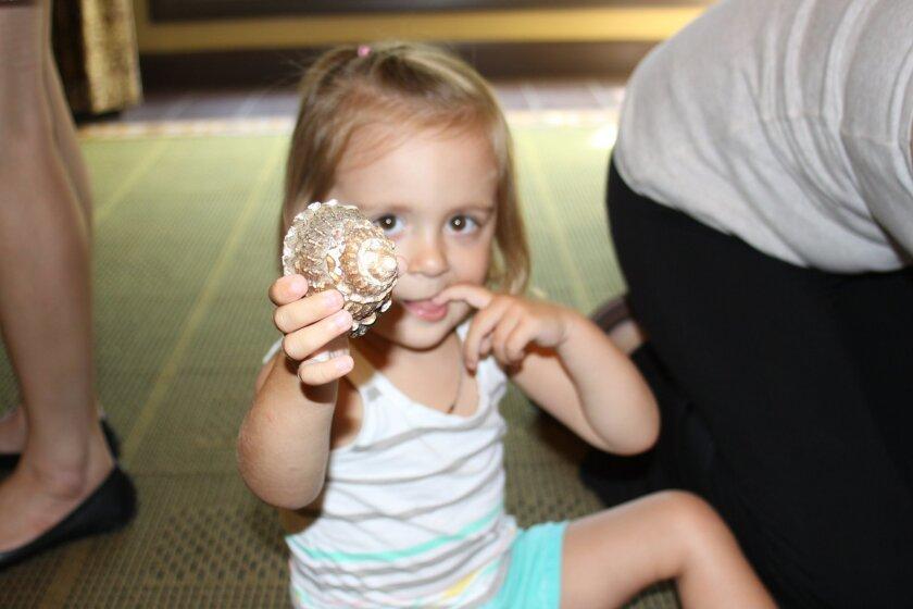Genevieve Buller checks out a snail shell.