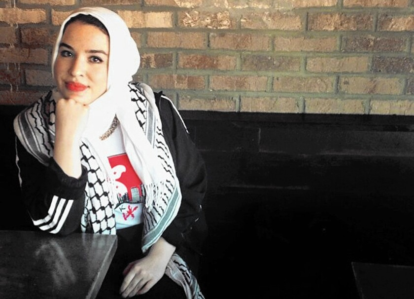 Leilah Abdennabi, a 24-year-old teacher's assistant, is Palestinian American and has worn a headscarf, or hijab, since she was 18. Although she has heard some Muslim women talk recently about taking off their headscarves to avoid harassment, she said she won't be removing hers.