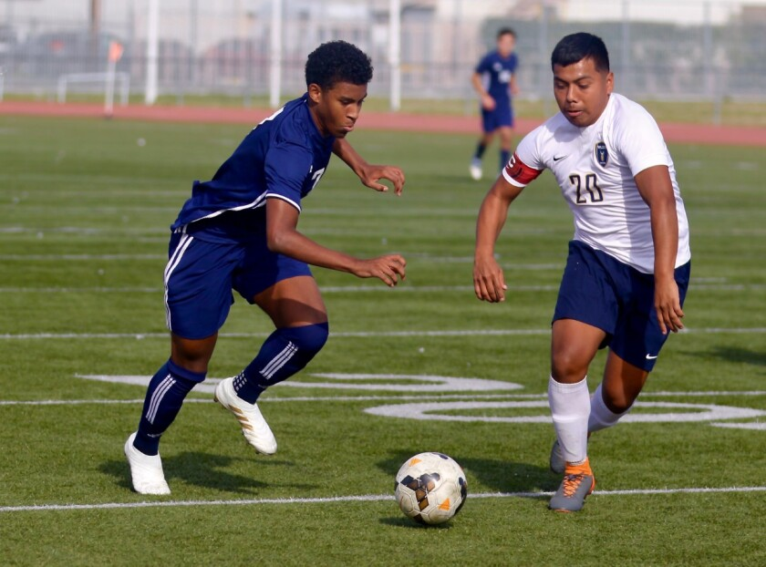 Palisades All-City soccer player Shane Thomas, left, in action last season.