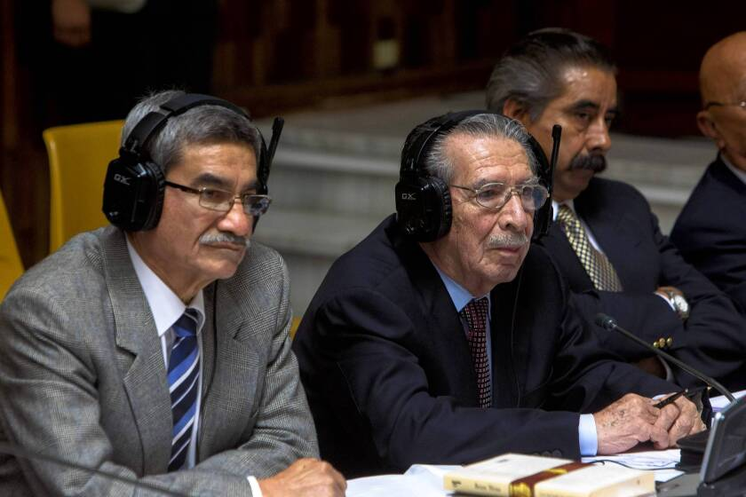 Guatemala's former president, Gen. Efrain Rios Montt, center, and his military intelligence chief, Jose Mauricio Rodriguez Sanchez, in court in Guatemala City.
