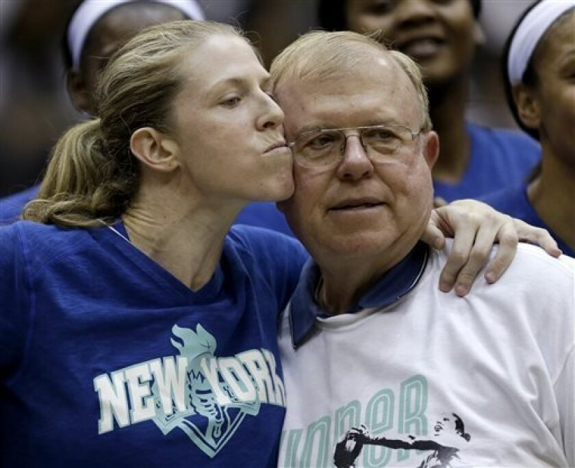 New York Liberty's Katie Smith, left, embraces her father, John Smith, Jr., during a pregame ceremony honoring Katie Smith's career before a WNBA basketball game against the Phoenix Mercury, Tuesday, Sept. 10, 2013, in Newark, N.J. (AP Photo/Julio Cortez)