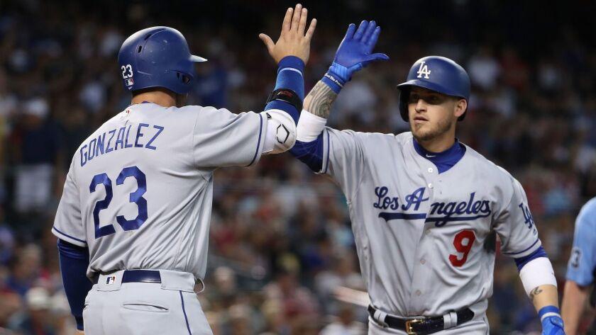PHOENIX, AZ - APRIL 23: Yasmani Grandal #9 of the Los Angeles Dodgers high fives Adrian Gonzalez #2