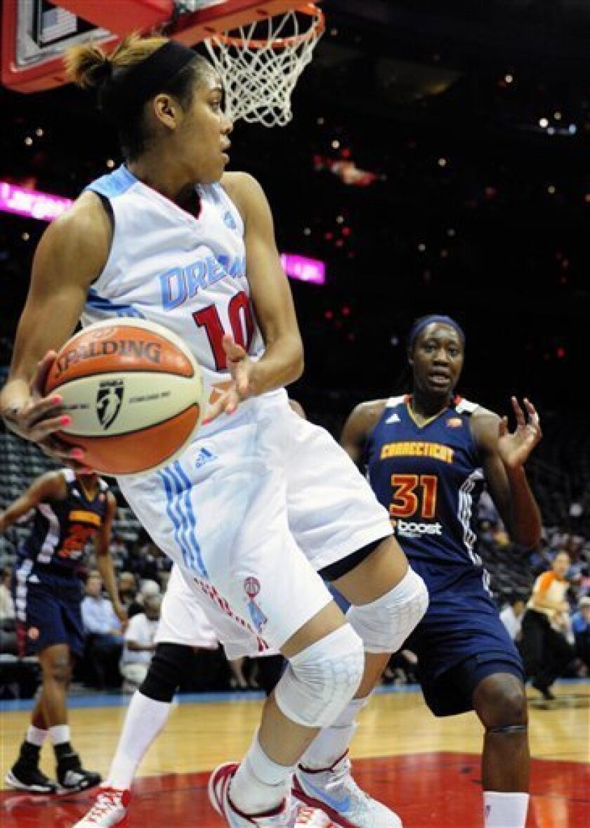 Atlanta Dream guard Lindsey Harding (10) saves the ball from going out of bounds in front of Connecticut Sun center Tina Charles (31) in the first half of their WNBA basketball game on Tuesday, Sept. 6, 2011 at Philips Arena in Atlanta. (AP Photo/David Tulis)