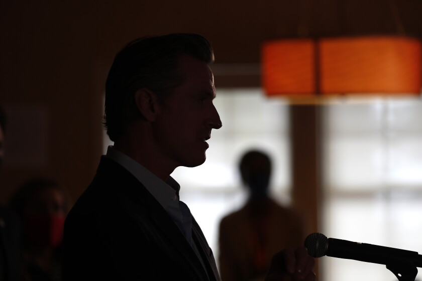 Gov. Gavin Newsom brags about what he says is a $76 billion state surplus.