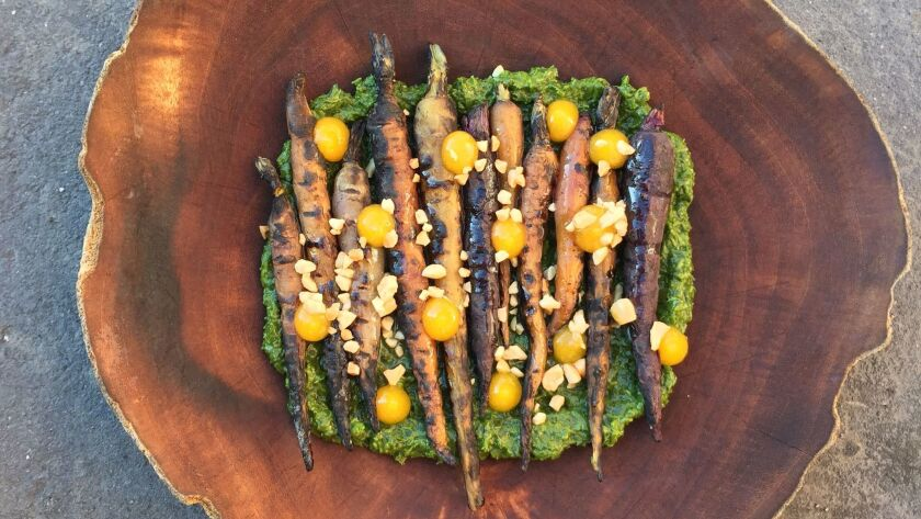BBQ carrots with jalapeño chimichurri, peanuts and pickled apricot puree by chef Anthony Wells at Juniper & Ivy restaurant in Little Italy.