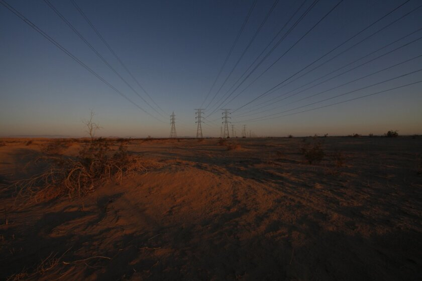 Transmission lines extend across the open desert southeast of San Diego.