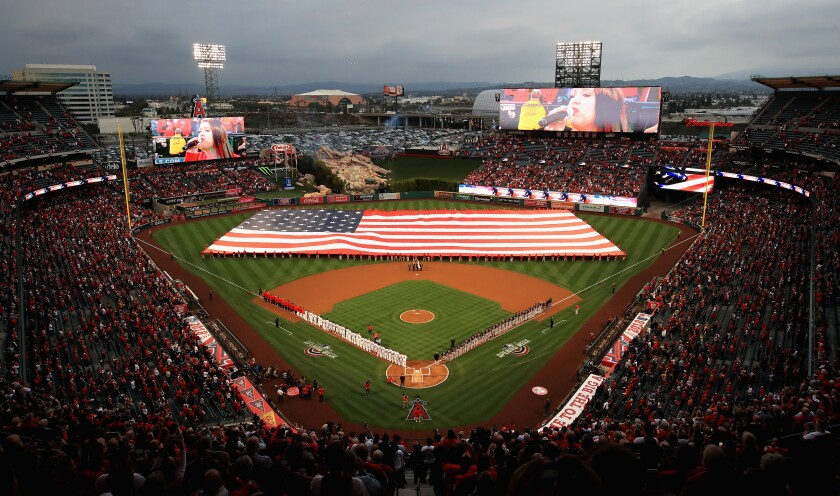 A large American flag is unfurled on the field at Angel Stadium before the team's home opener against the Cleveland Indians in April 2018.
