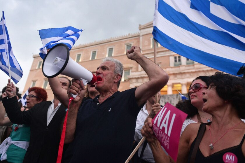 Pro-Euro demonstrators rally in front of the parliament building in Athens on Tuesday, ahead of a weekend referendum.