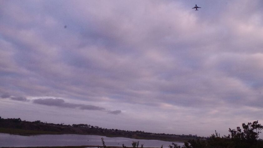 A jet departing John Wayne Airport on Friday morning is about to bank left near the Bluffs neighborh