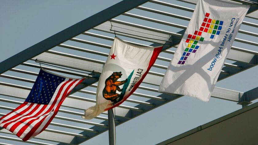 Flags fly outside West Hollywood City Hall. A Los Angeles jury Friday ruled in favor of the city in a trial with allegations of wrongful termination and retaliation.