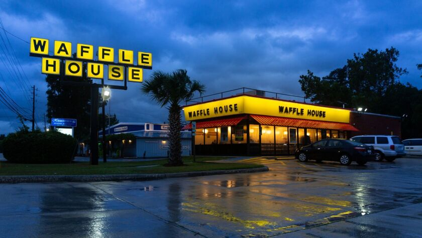 Waffle House staff in Wilmington, N.C. say they plan to stay open through Hurricane Florence despite torrential rain and harsh winds.
