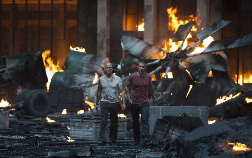 "Bruce Willis and Jai Courtney in ""A Good Day to Die Hard."""