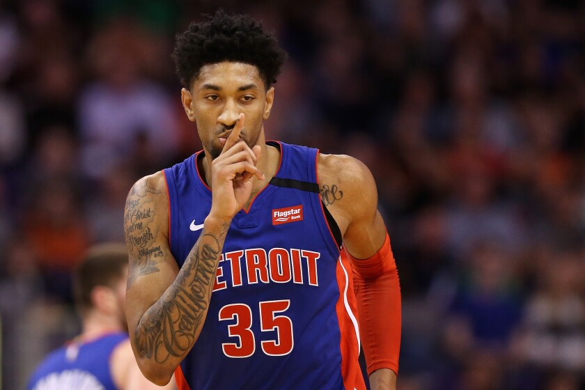 Pistons power forward Christian Wood reacts after making a three-pointer against the Suns during a game Feb. 28, 2020, in Phoenix.
